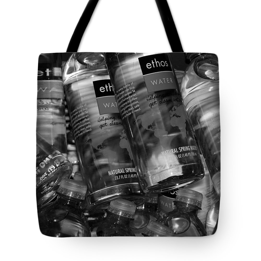 Water Bottles Tote Bag featuring the photograph Bottles Of Water by Rob Hans