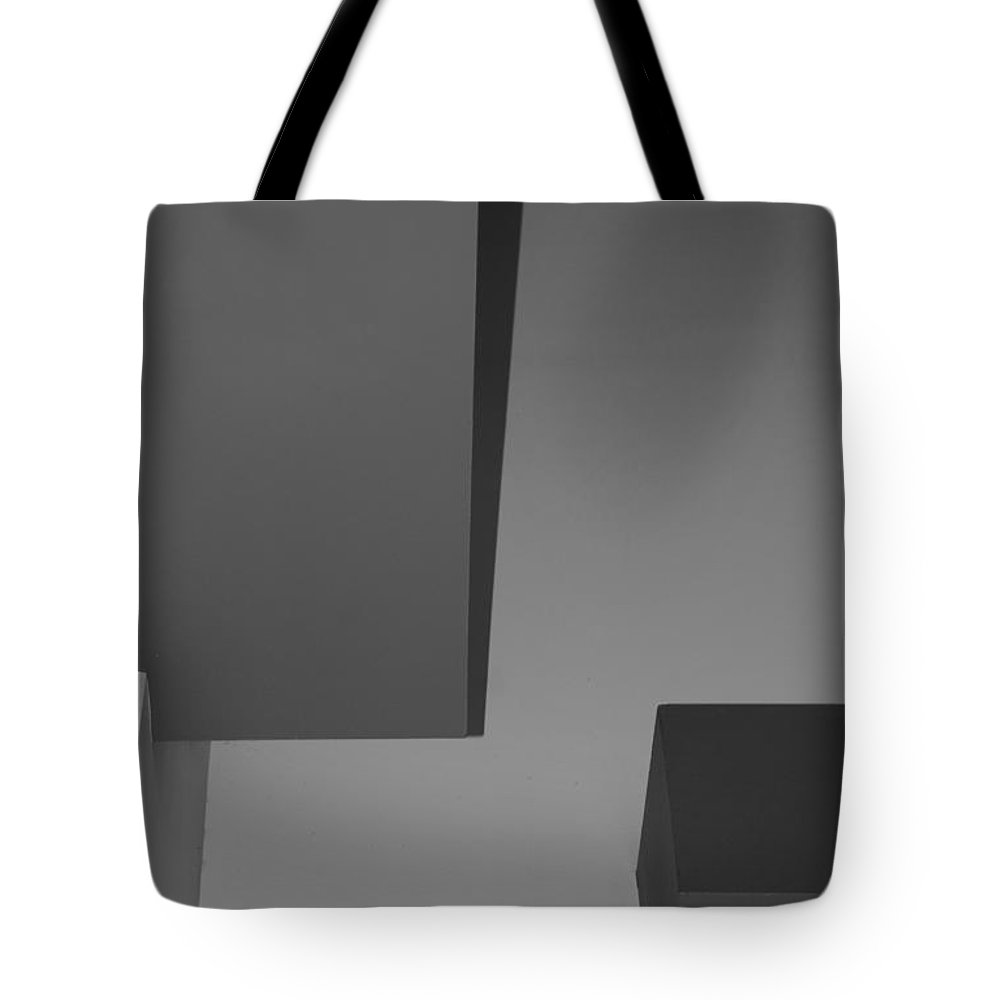 Black And White Tote Bag featuring the photograph Boxes On The Wall by Rob Hans