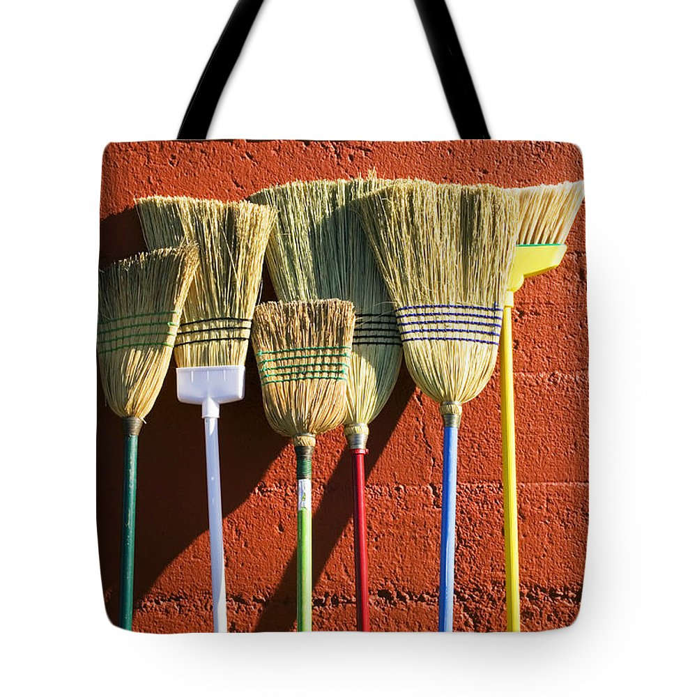 Broom Tote Bag featuring the photograph Brooms Leaning Against Wall by Garry Gay