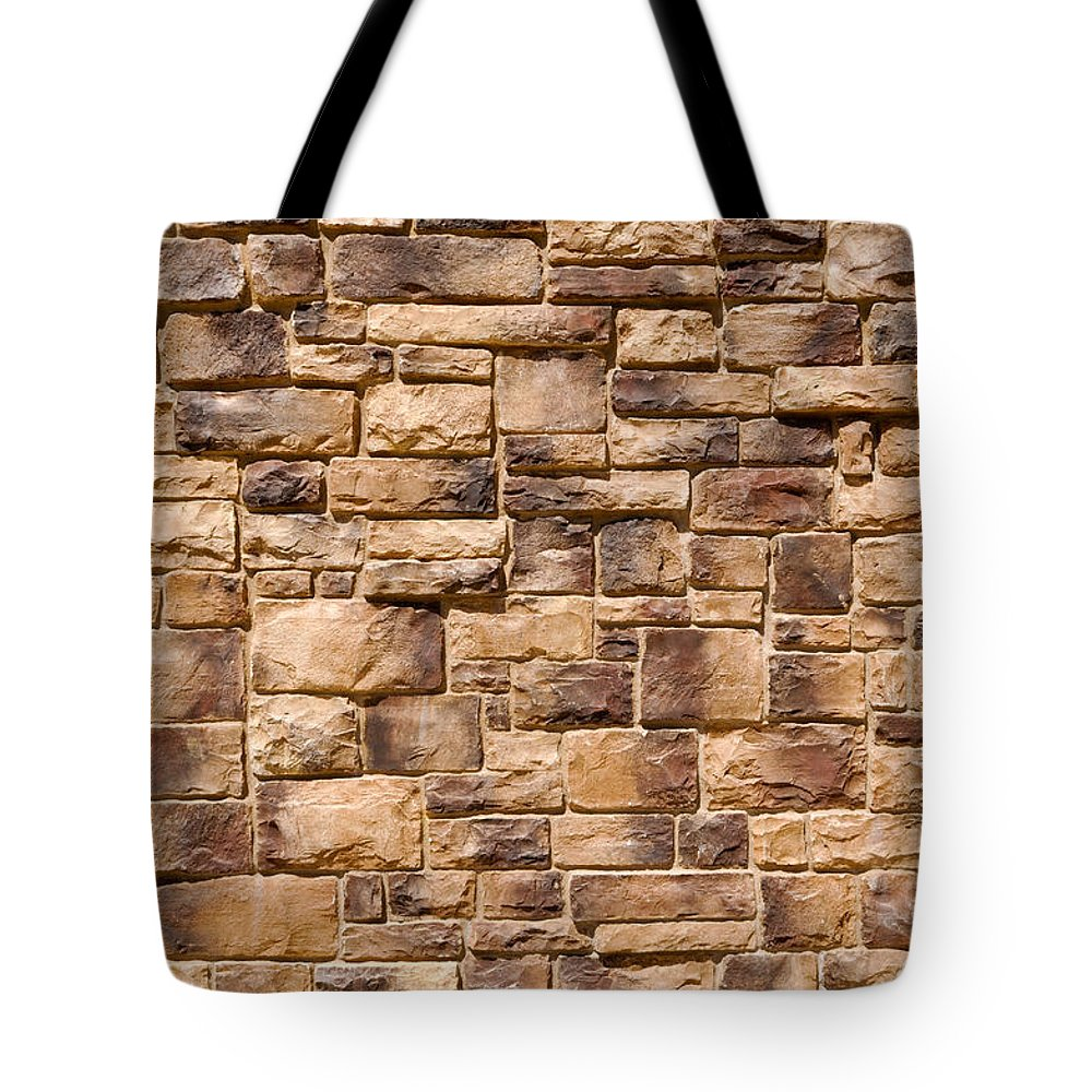 Stone Tote Bag featuring the photograph Brown Brick Wall by Brandon Bourdages
