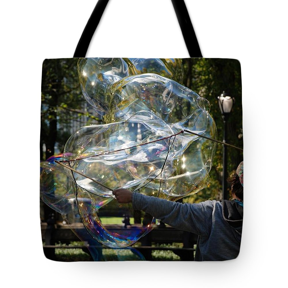 Black And White Tote Bag featuring the photograph Bubble Blowr Of Central Park by Rob Hans