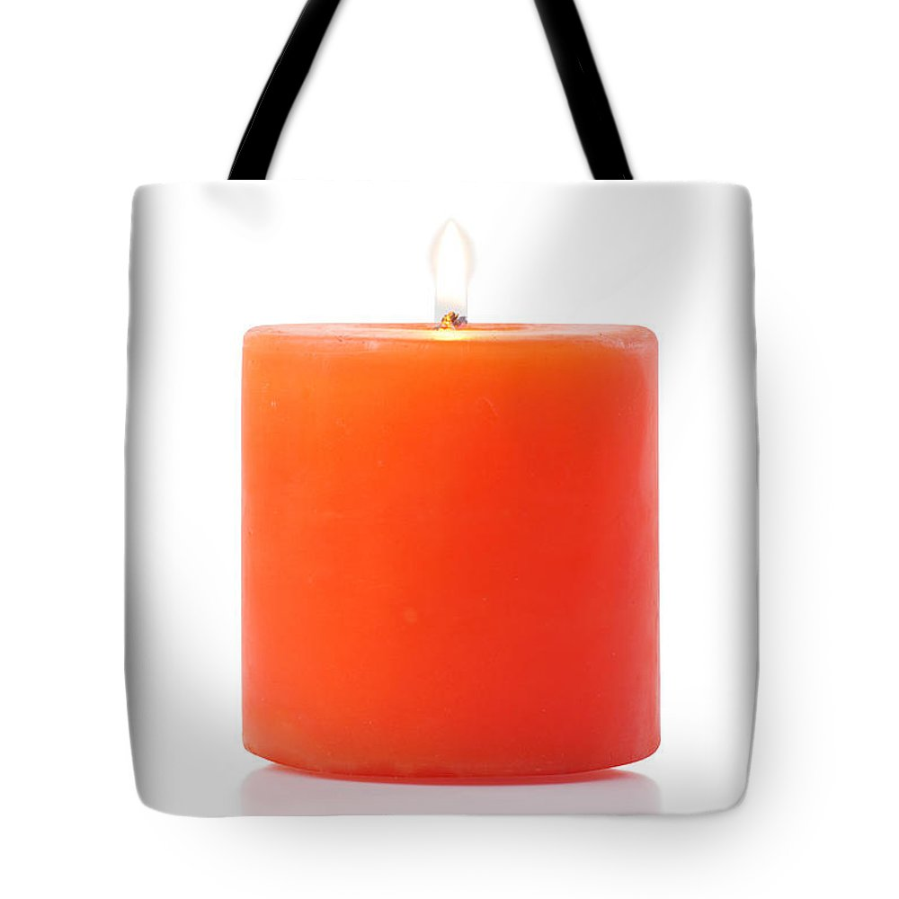 Candle Tote Bag featuring the photograph Burning Red Candle by Atiketta Sangasaeng