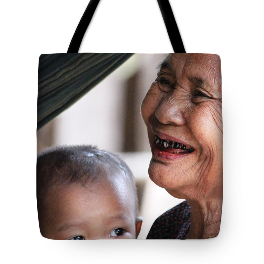 Smile Tote Bag featuring the photograph Cambodian Grandmother And Baby #2 by Nola Lee Kelsey
