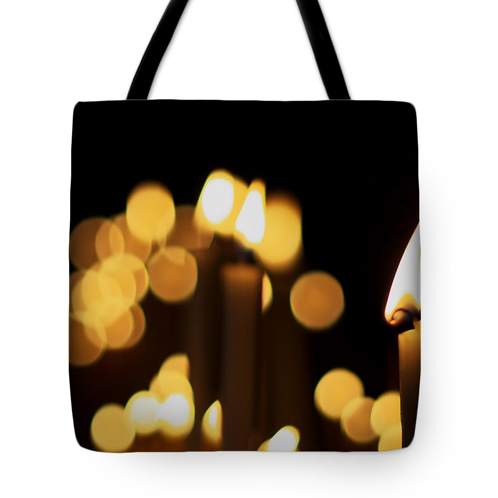 Candle Tote Bag featuring the photograph Candle Light by Ivan Slosar