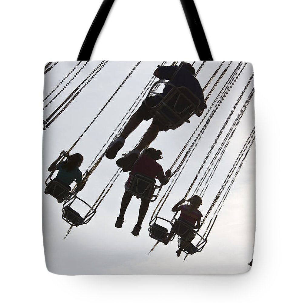 Color Image Tote Bag featuring the photograph Carnival Goers Enjoy A Ride At An by Stacy Gold