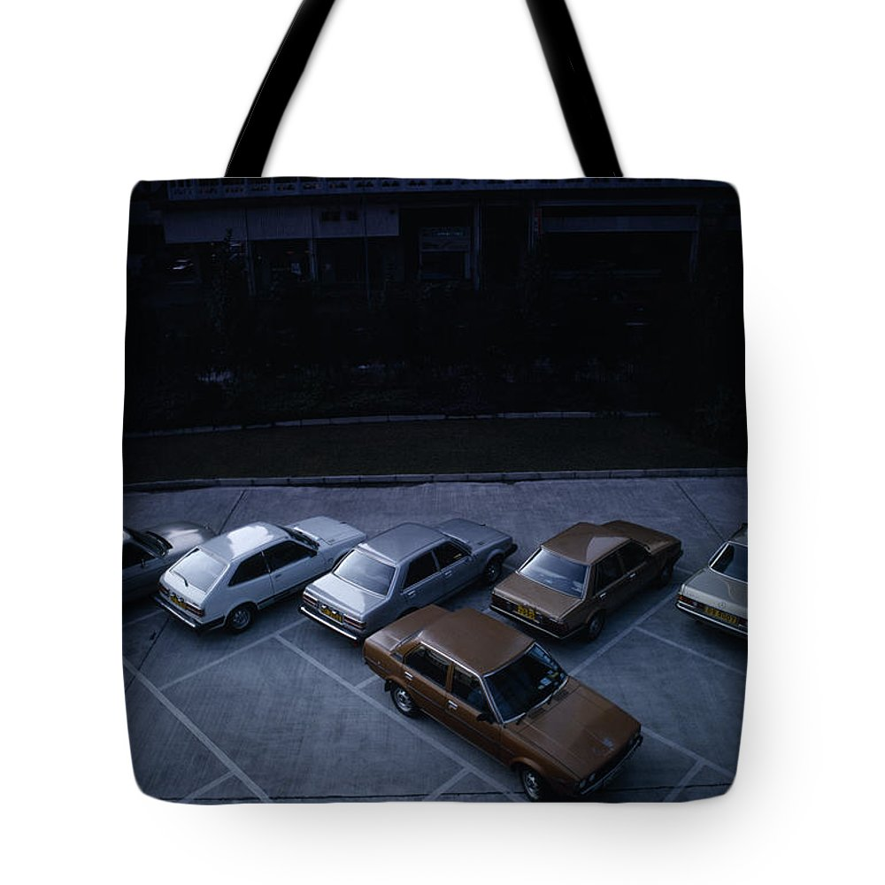 Asia Tote Bag featuring the photograph Cars In Hong Kong by Shaun Higson