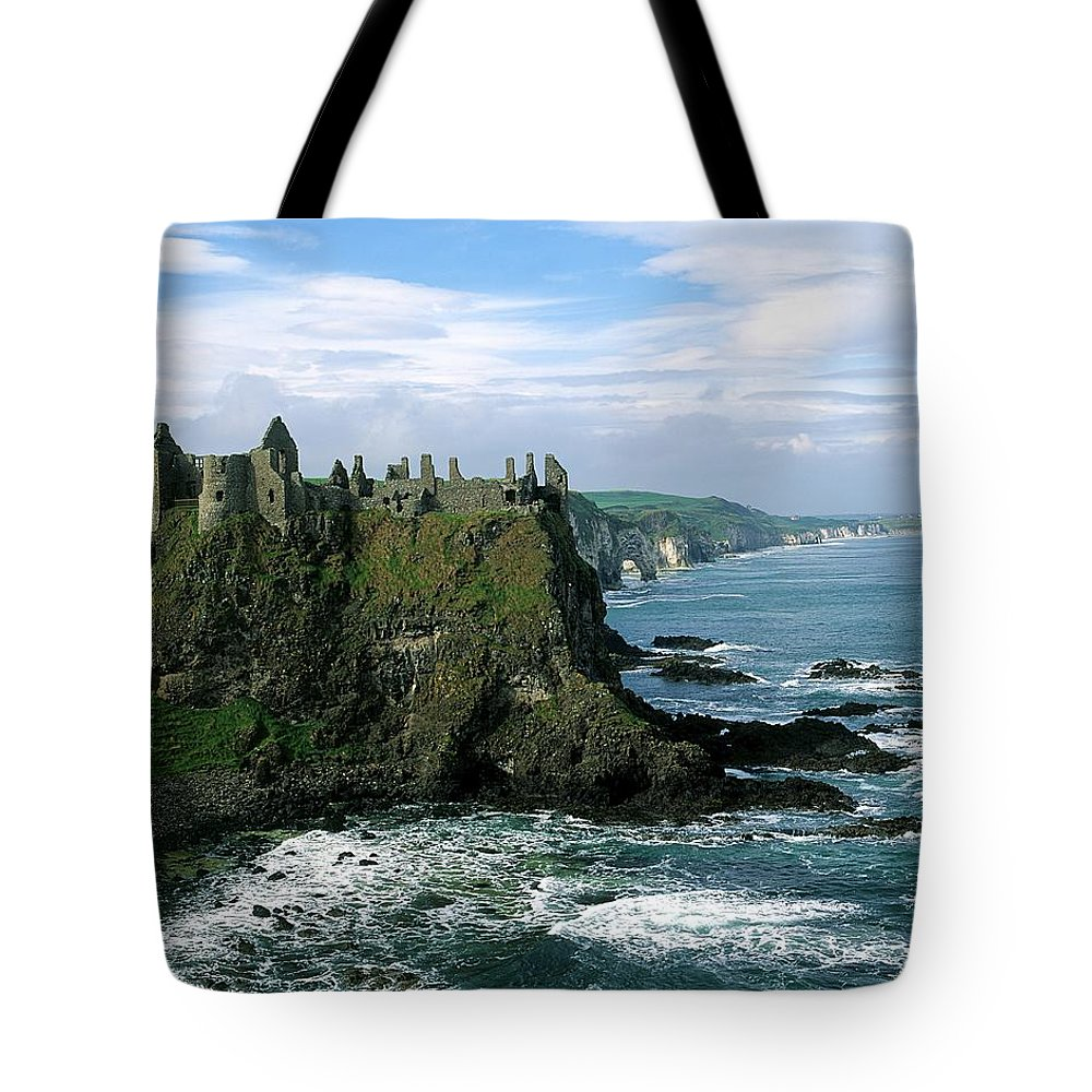 Building Exterior Tote Bag featuring the photograph Castle At The Seaside, Dunluce Castle by The Irish Image Collection