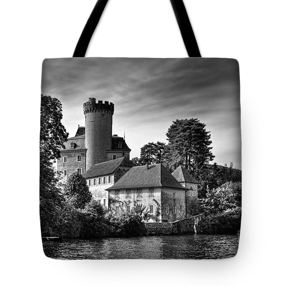 Annecy Tote Bag featuring the photograph Chateau On The Lake At Annecy by Ann Garrett