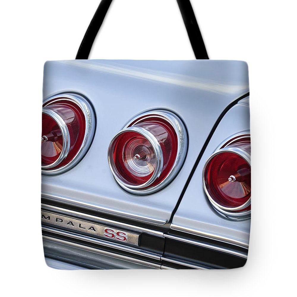 Chevrolet Impala Ss Tote Bag featuring the photograph Chevrolet Impala Ss Taillight by Jill Reger