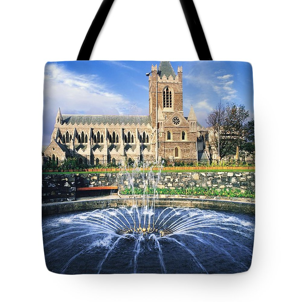Blue Sky Tote Bag featuring the photograph Christ Church Cathedral, Synod Hall by The Irish Image Collection