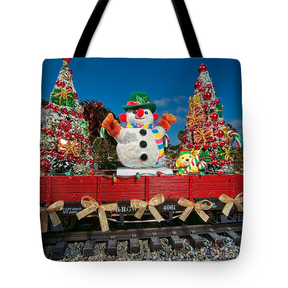 Snowman Tote Bag featuring the photograph Christmas Snowman On Rails by Christopher Holmes