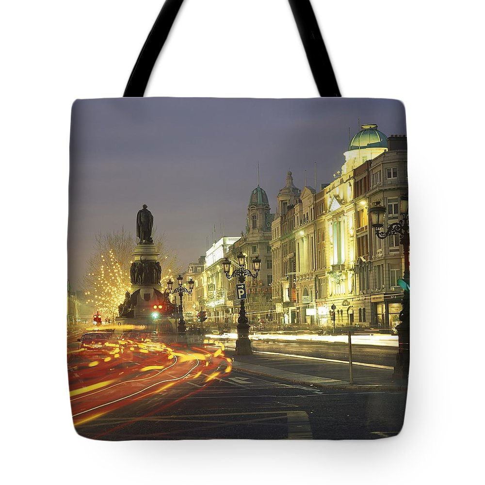 County Dublin Tote Bag featuring the photograph Christmas Traffic On Oconnell Street by The Irish Image Collection