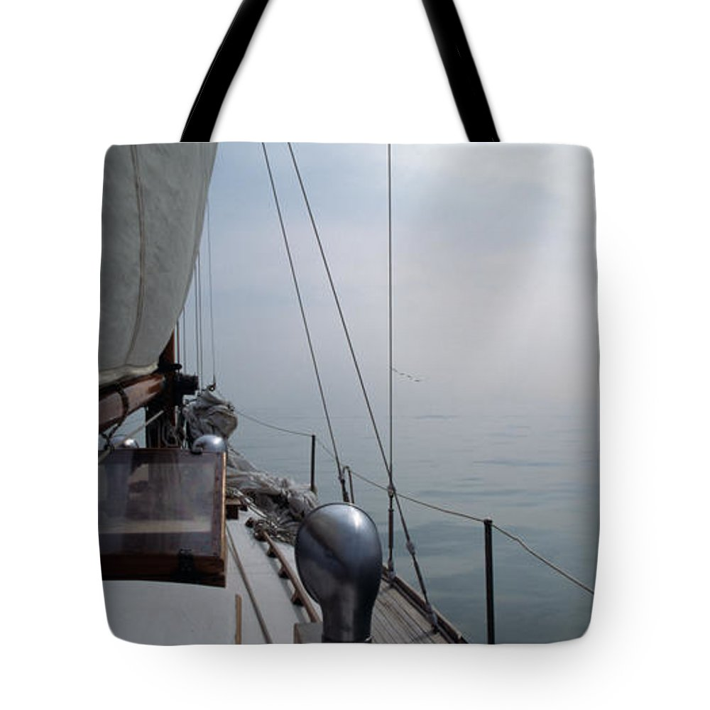 Sail Tote Bag featuring the photograph Classic Wooden Sailboat With No Horizon Off The Bow by John Harmon