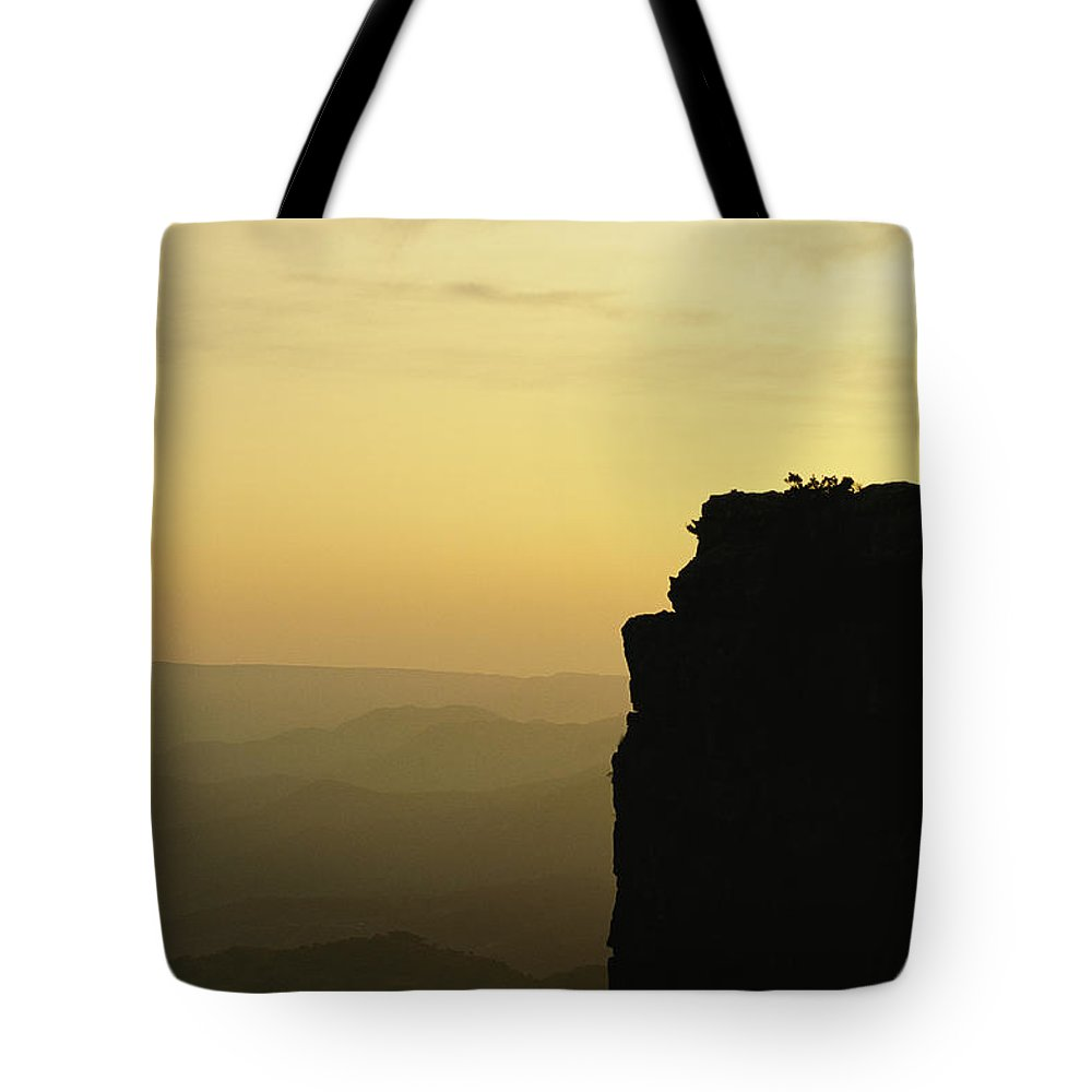 Transvaal Province Tote Bag featuring the photograph Climber Amy Whisler Stands Silhouetted by Bill Hatcher