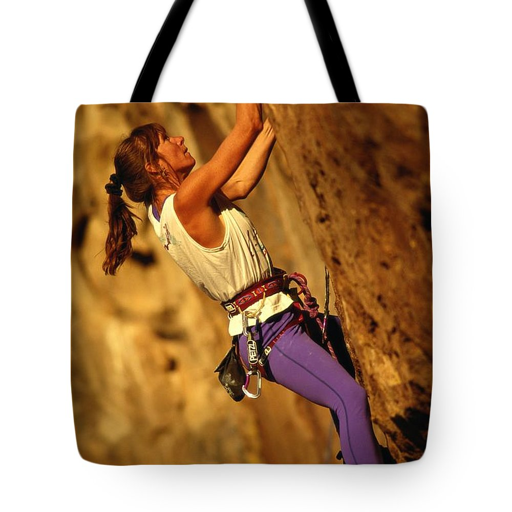 North America Tote Bag featuring the photograph Climber Heidi Badaracco Leads A Route by Bill Hatcher