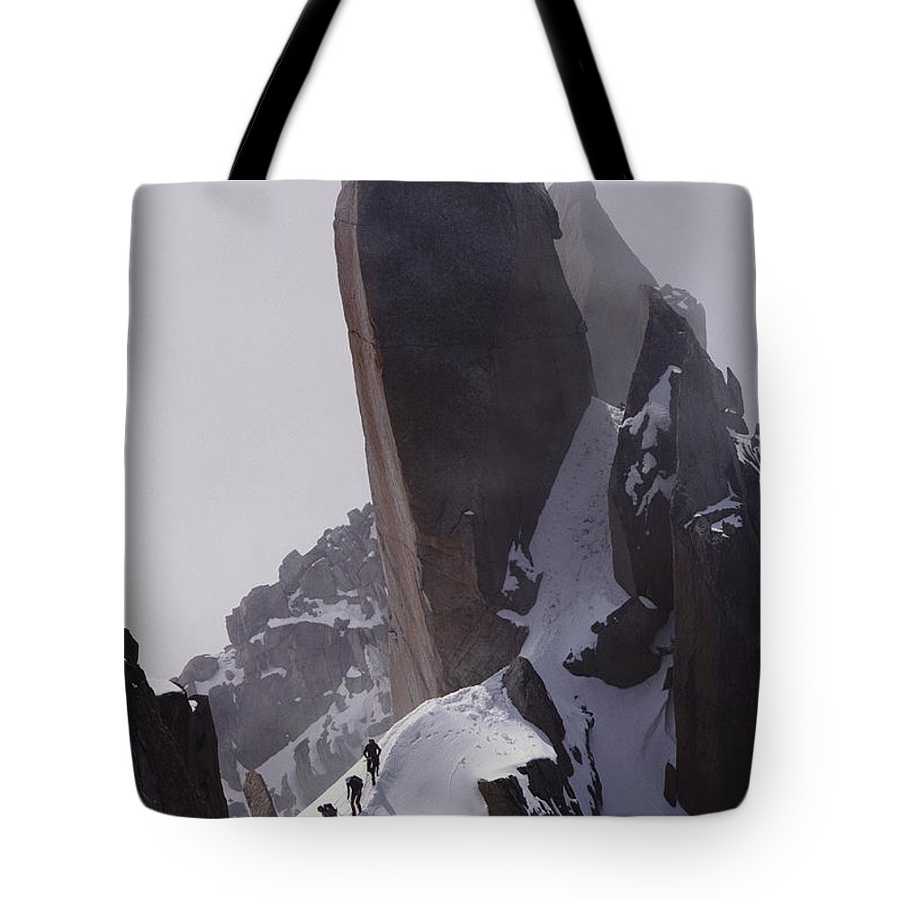 Alps Tote Bag featuring the photograph Climbers Move Carefully Across Steep by Paul Chesley