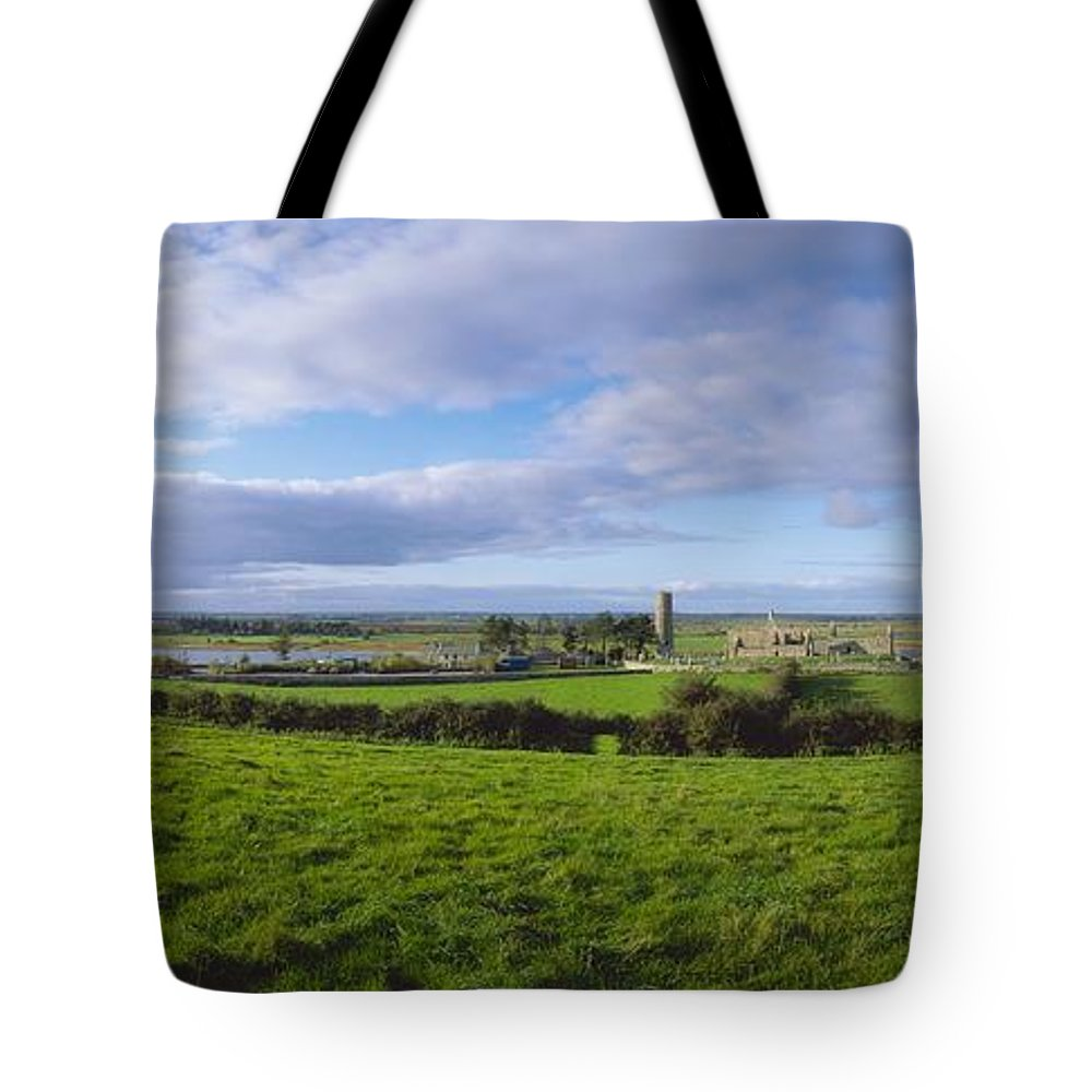 Co Offaly Tote Bag featuring the photograph Clonmacnoise, Co Offaly, Ireland by The Irish Image Collection