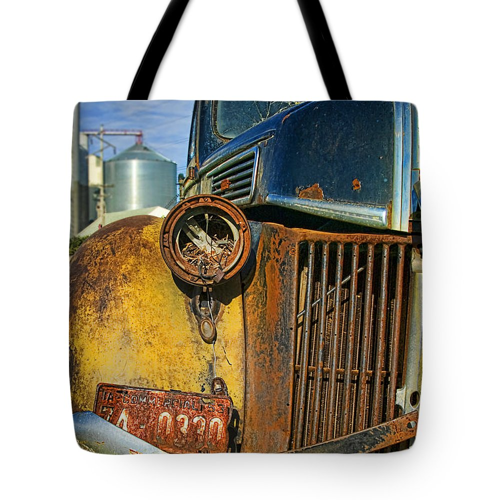 Truck Tote Bag featuring the photograph Close Up Of Rusty Truck by Jill Battaglia