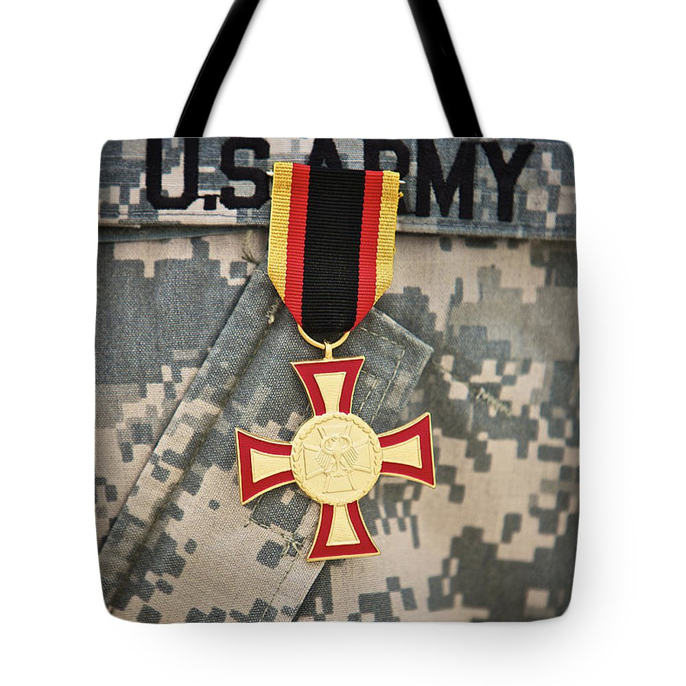 Operation Enduring Freedom Tote Bag featuring the photograph Close-up View Of A German Gold Cross by Terry Moore