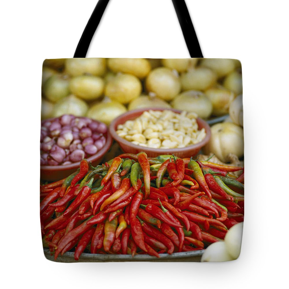 vietnam Tote Bag featuring the photograph Close View Of Chili Peppers And Other by Steve Raymer