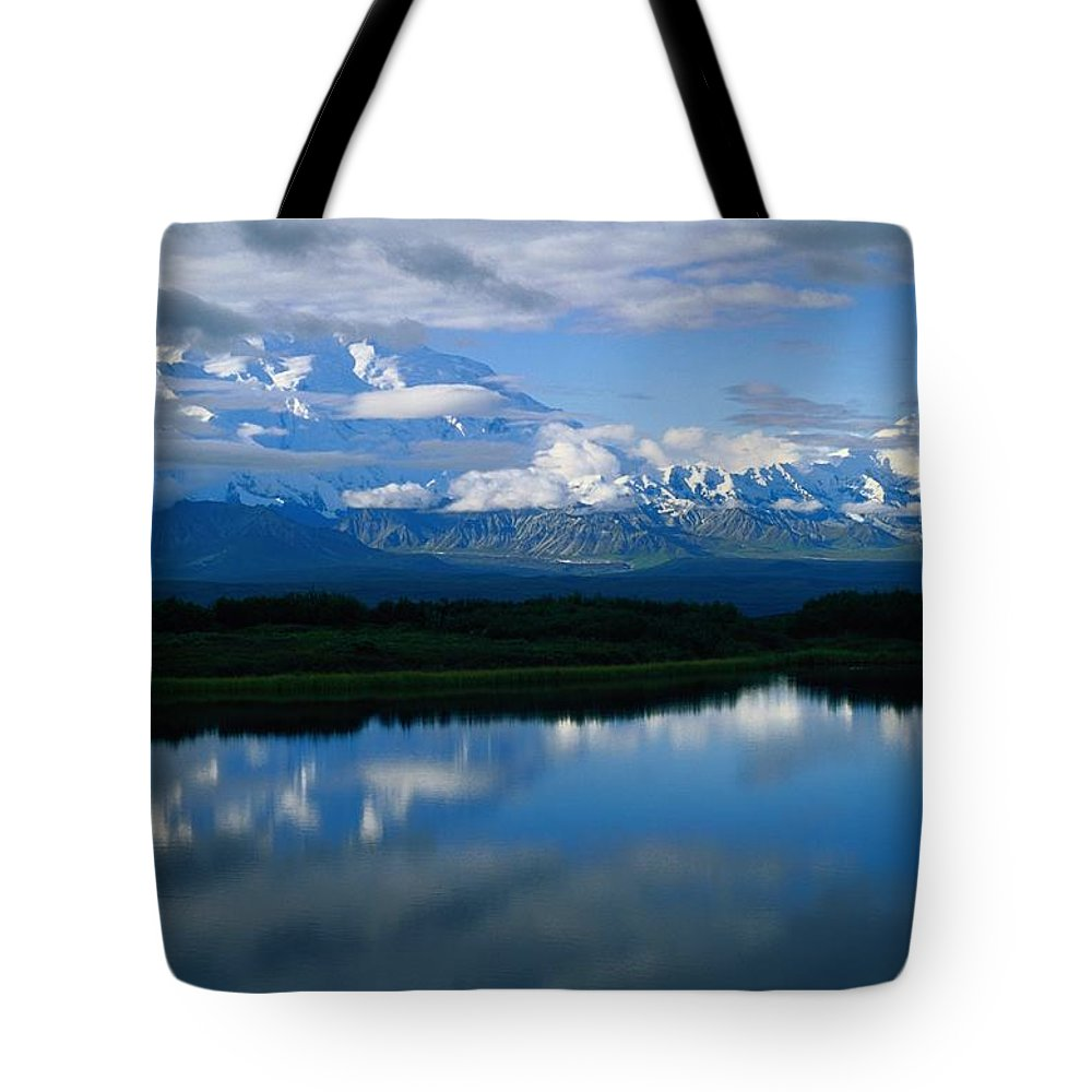 Mount Mc Kinley Tote Bag featuring the photograph Cloud-enshrouded Mt. Mckinley Reflected by Anne Keiser