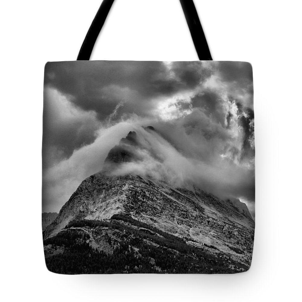 Grinnell Point Tote Bag featuring the photograph Cloud Fingers by Adam Jewell