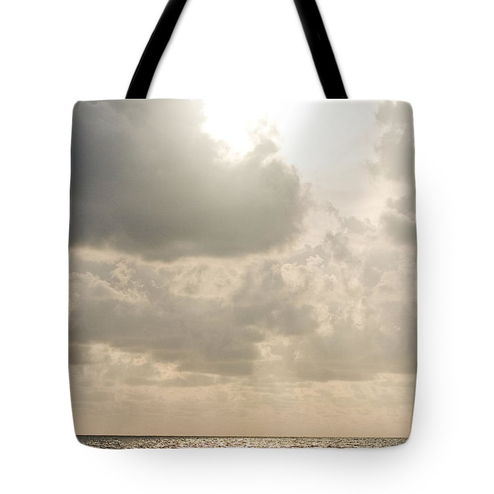 Ocean Tote Bag featuring the photograph Clouded Sky by Lisha Segur