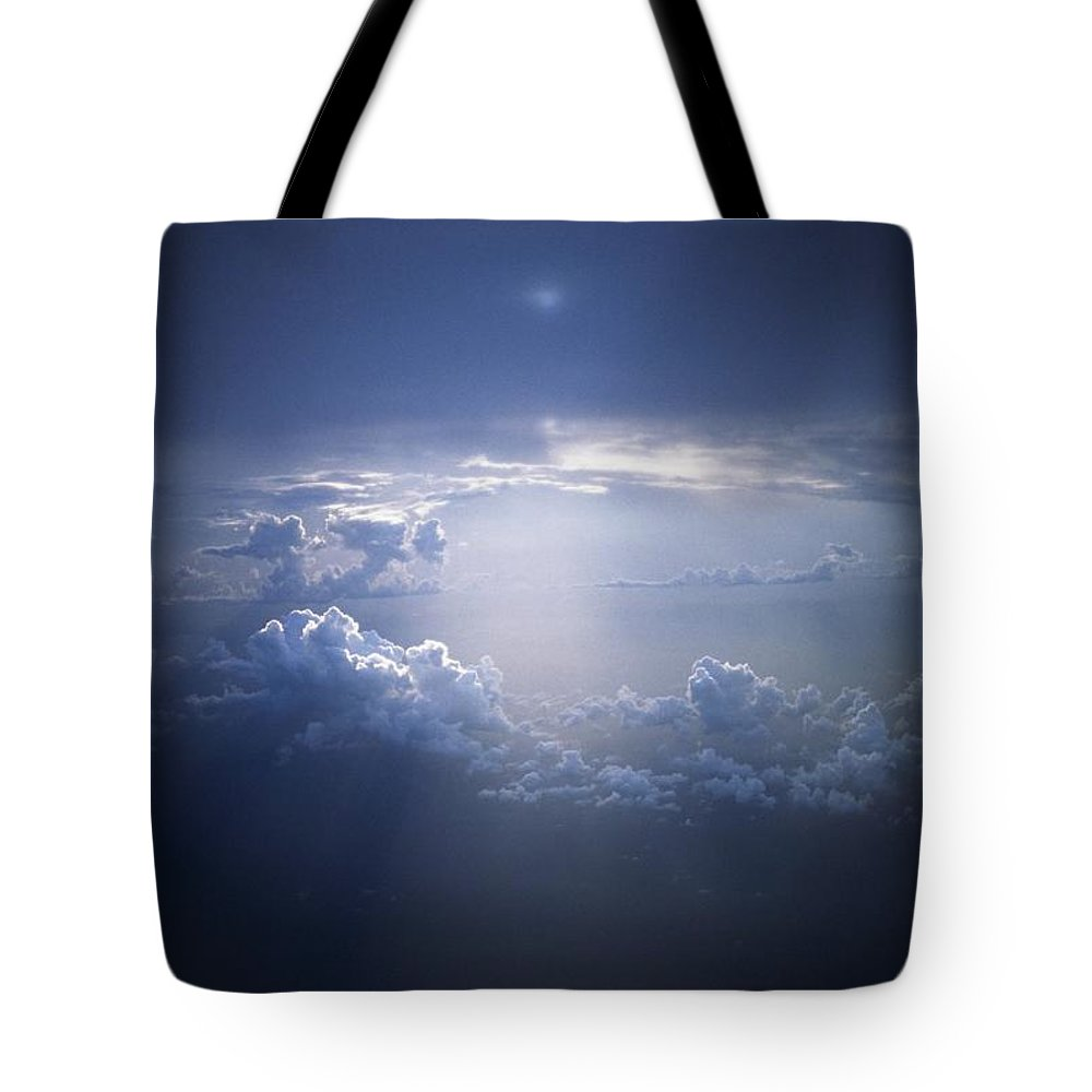 Weather Tote Bag featuring the photograph Clouds Sunlight Breaking Through Clouds by Sici