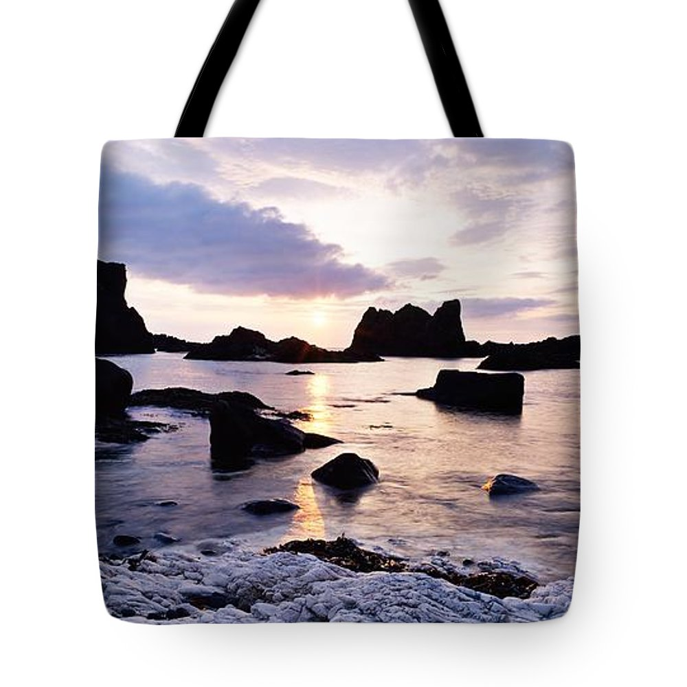 Back Lit Tote Bag featuring the photograph Co Antrim, Whitepark Bay, Ballintoy by The Irish Image Collection