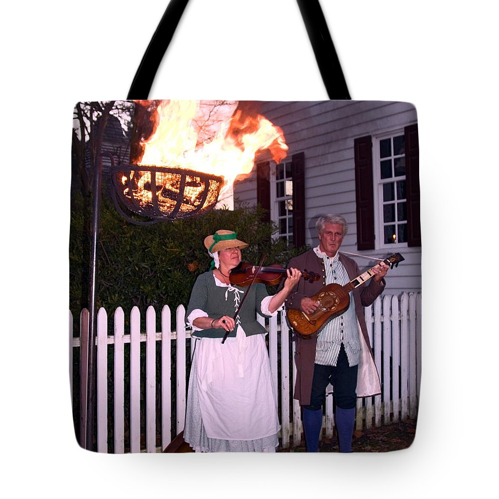 2 Musicians Playing Tote Bag featuring the photograph Colonial Musicians By Firelight by Sally Weigand