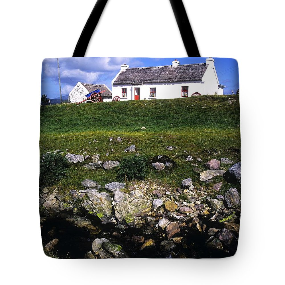 Travel Destination Tote Bag featuring the photograph Cottage On Achill Island, County Mayo by The Irish Image Collection