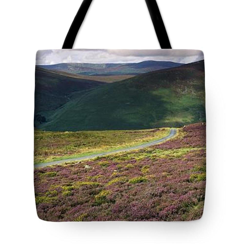 Cloud Tote Bag featuring the photograph Country Road Passing Through A by The Irish Image Collection