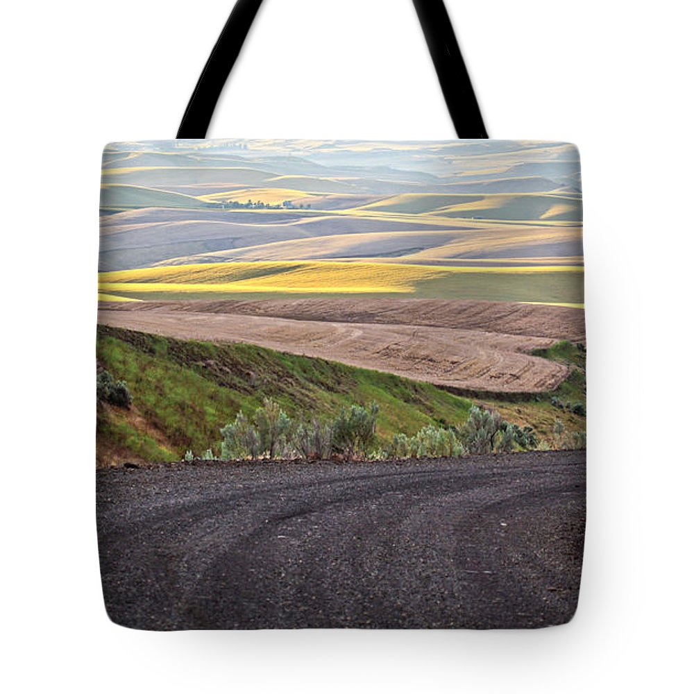 Roads Tote Bag featuring the photograph Country Road by Steve McKinzie