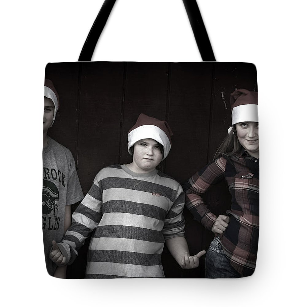 Tote Bag featuring the photograph Cousins by Gray Artus