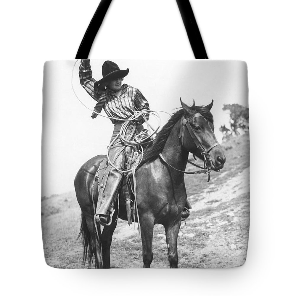 1920 Tote Bag featuring the photograph Cowgirl, C1920 by Granger