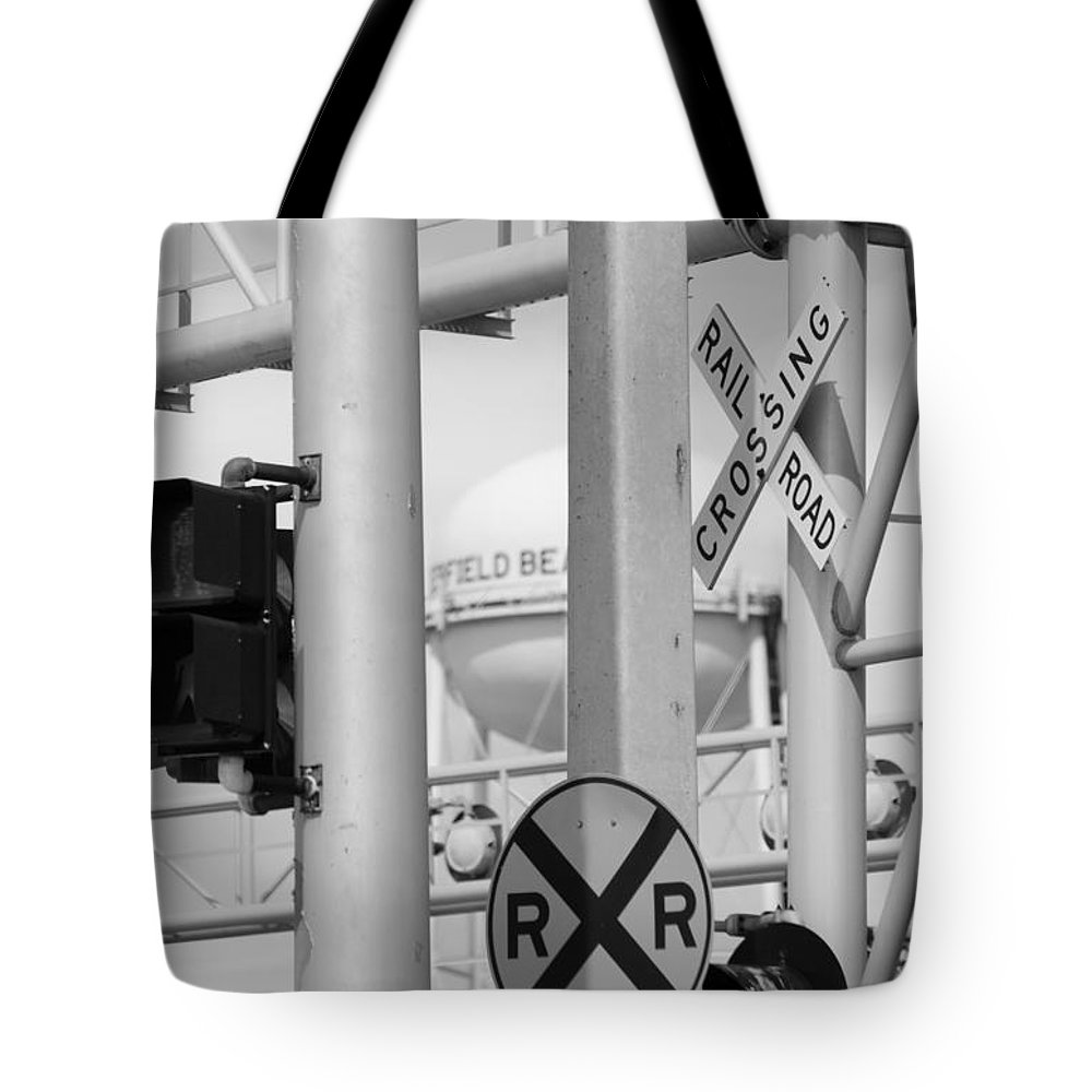 Black And White Tote Bag featuring the photograph Crossing Signs In Black And White by Rob Hans