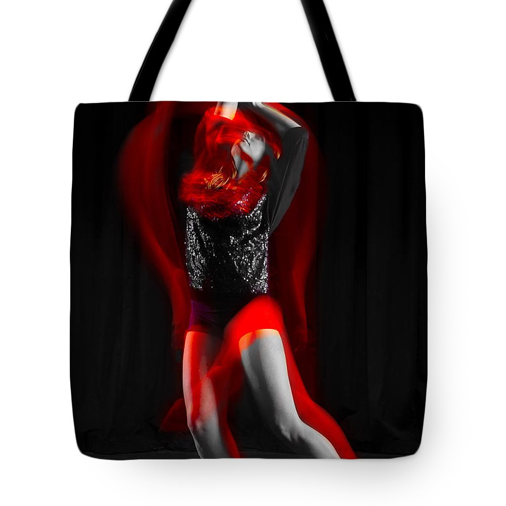Photography Tote Bag featuring the photograph Dancing With Fire by Frederic A Reinecke