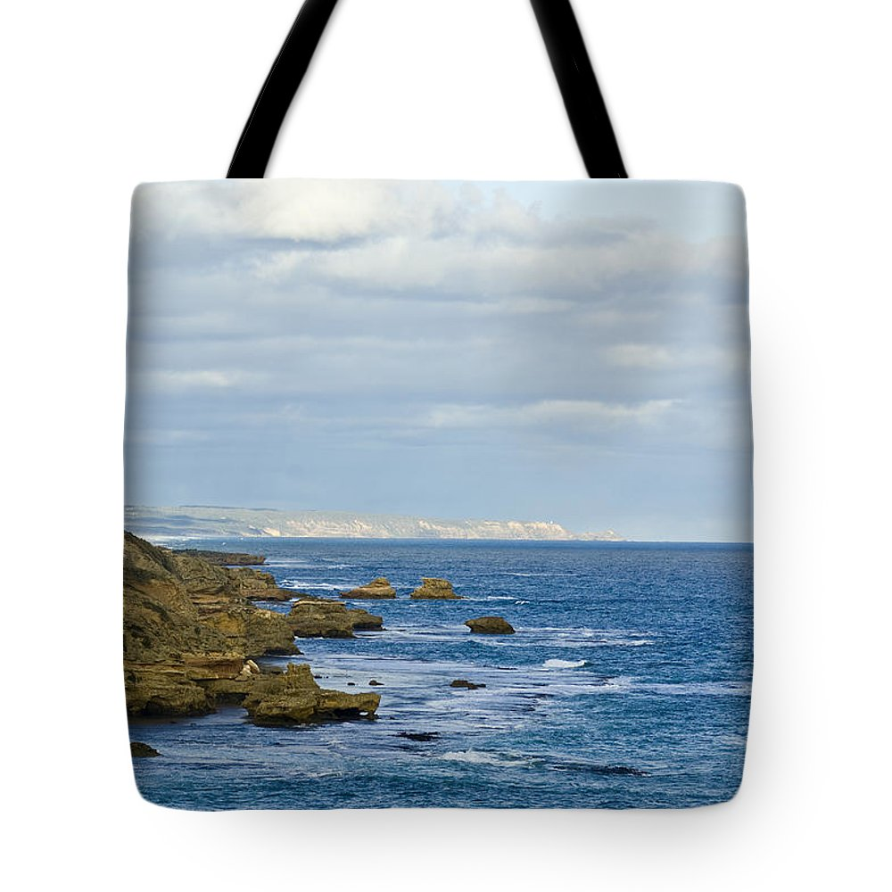 Color Image Tote Bag featuring the photograph Dappled Sunlight Falls Across Rugged by Jason Edwards