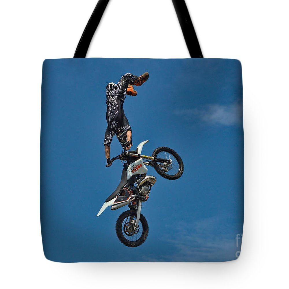 Motorcycle Tote Bag featuring the photograph Daredevil Motorcyclist by Andrea Kollo