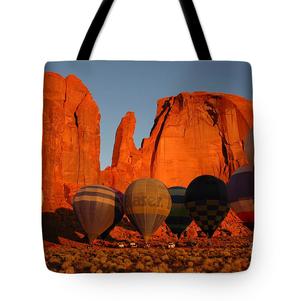 Hot Air Balloons Tote Bag featuring the photograph Dawn Flight In Monument Valley by Vivian Christopher