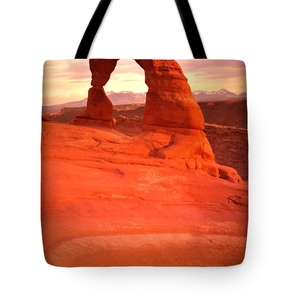 Delicate Arch Tote Bag featuring the photograph Delicate Arch At Sunset by Tara Turner