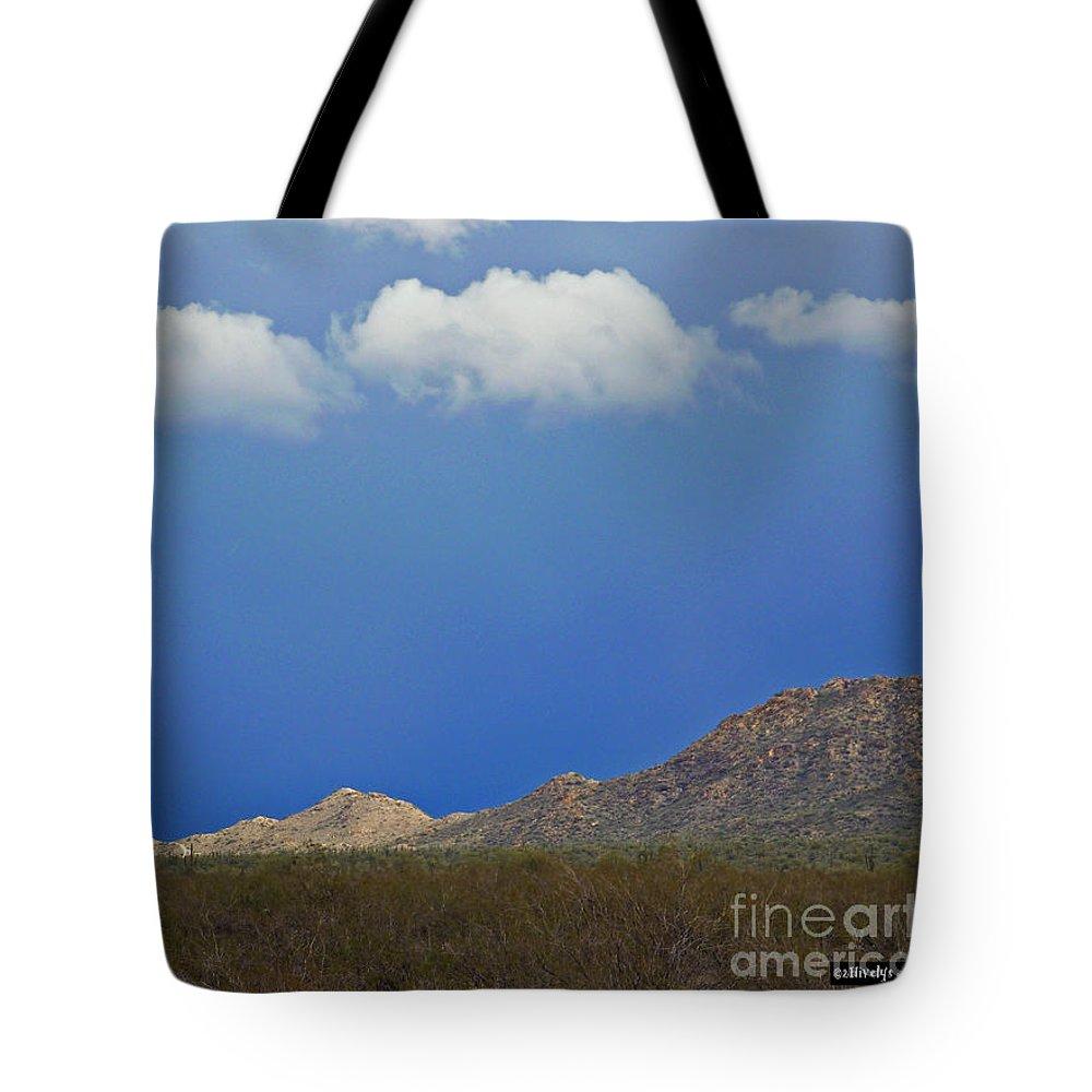 Desert Rain Tote Bag featuring the photograph Desert Rain by Methune Hively