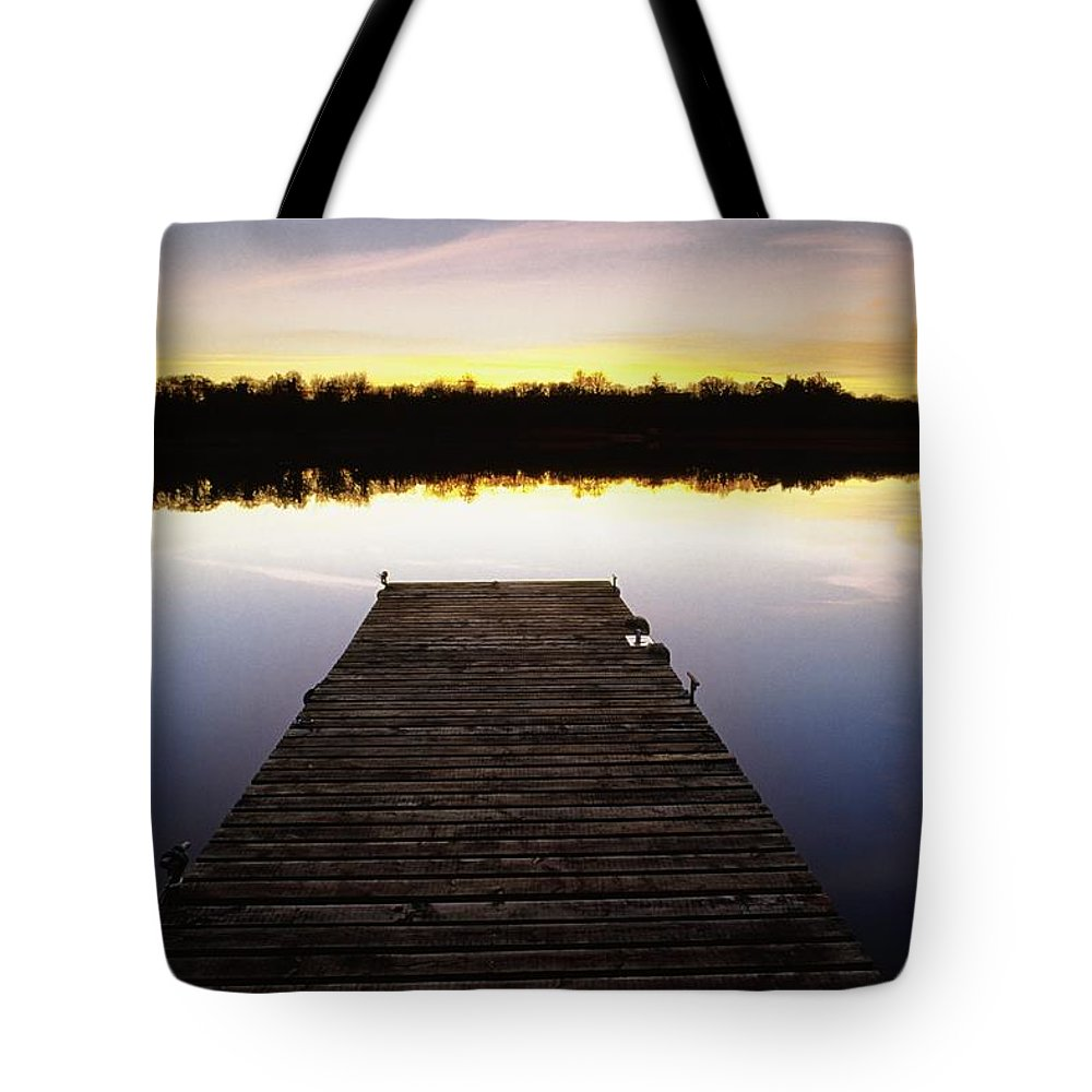 Sunset Tote Bag featuring the photograph Dock At Sunset by Gareth McCormack
