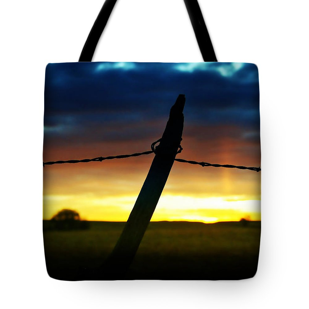 Sunrise Tote Bag featuring the photograph Don't Fence Me In by Ellen Heaverlo