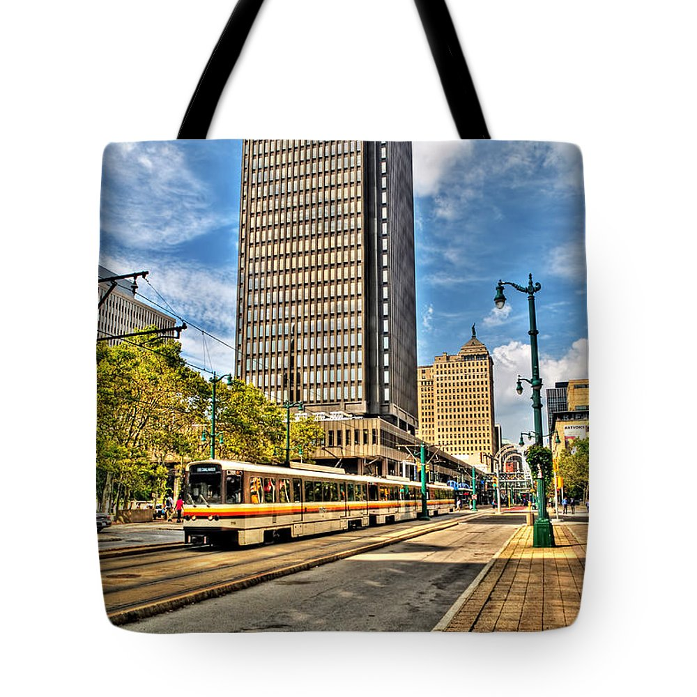 Tote Bag featuring the photograph Downtown Buffalo Metro Rail Heading To The Erie Canal Harbor by Michael Frank Jr