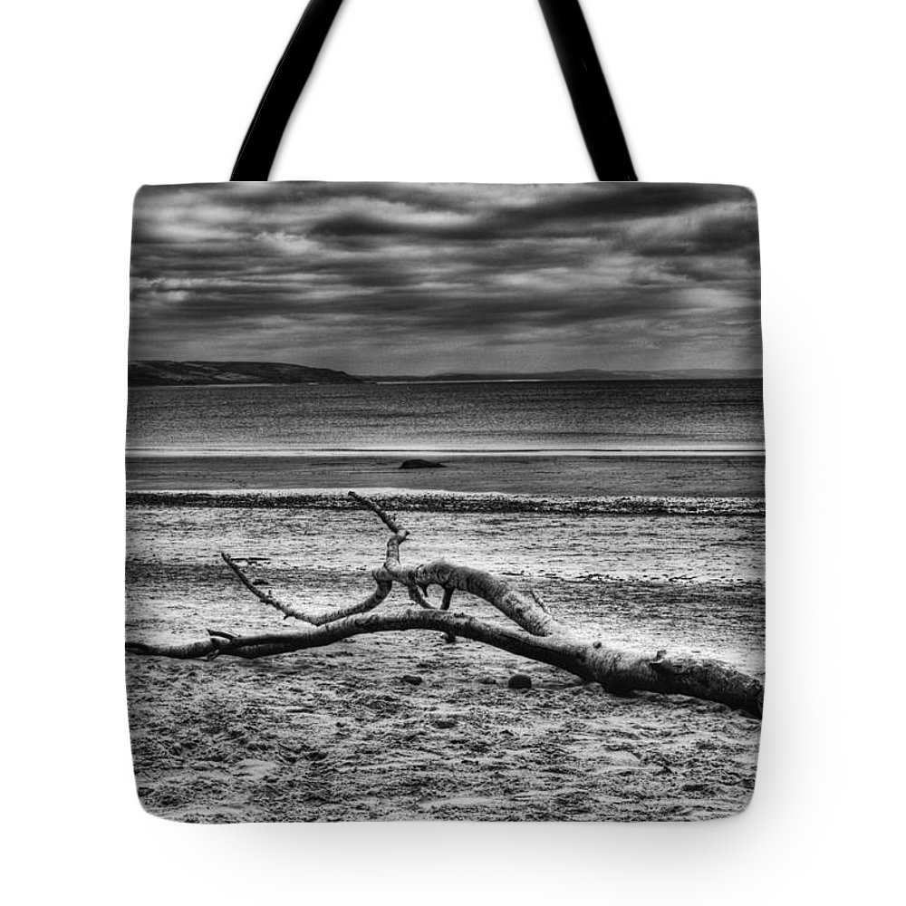 Driftwood Tote Bag featuring the photograph Driftwood Mono by Steve Purnell