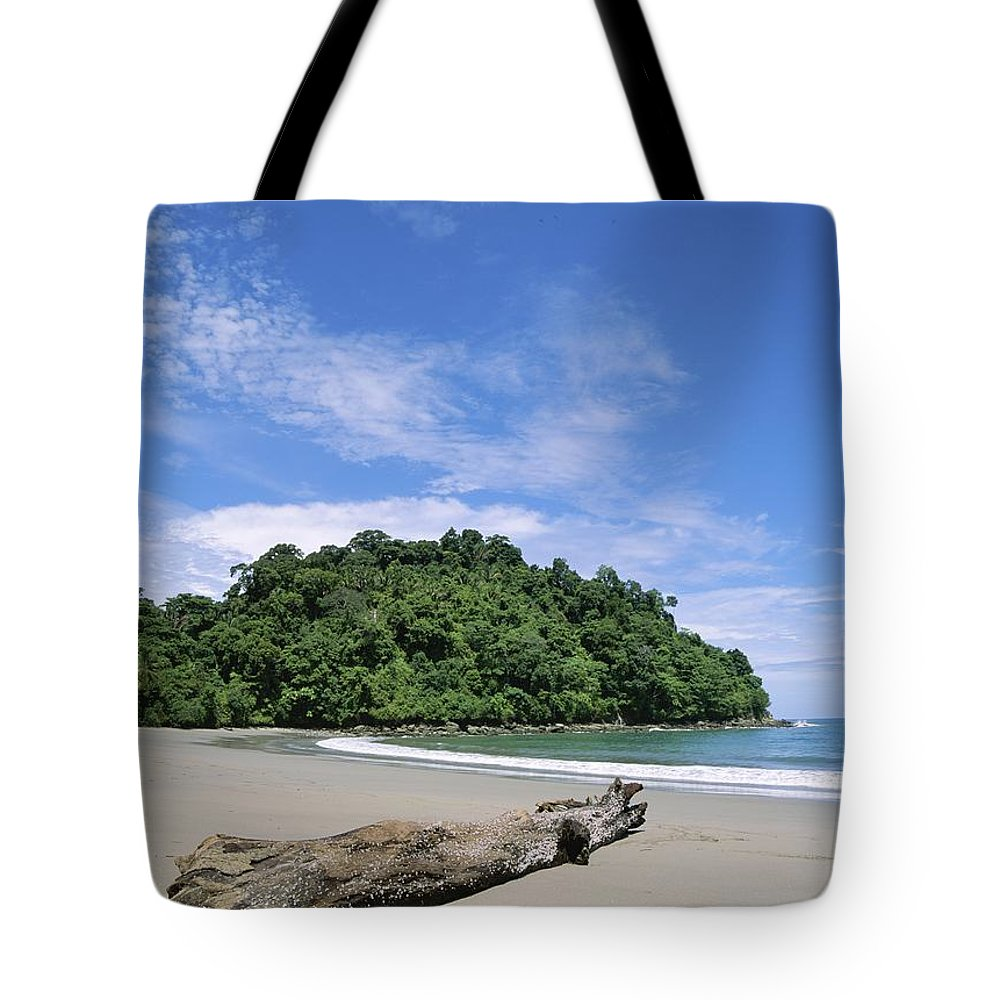 Central America Tote Bag featuring the photograph Driftwood On A Tropical Beach Bordered by Mattias Klum