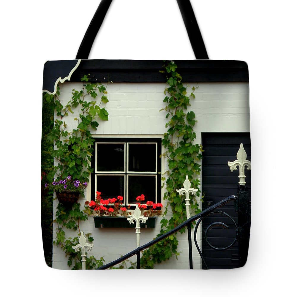 Black And White Tote Bag featuring the photograph Dutch Delight by Lainie Wrightson