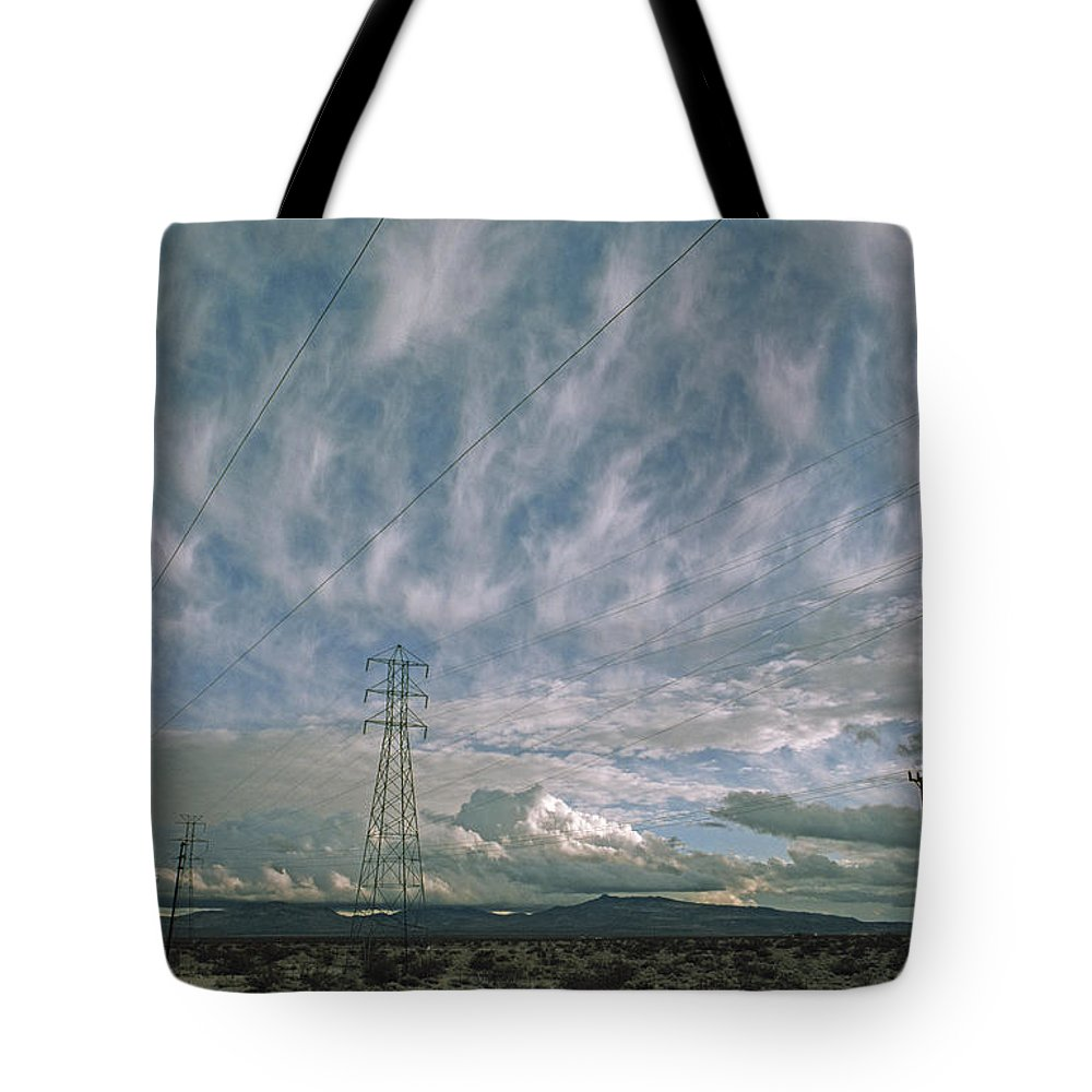 Cirrus Tote Bag featuring the photograph Electric Transmission Lines by Gordon Wiltsie