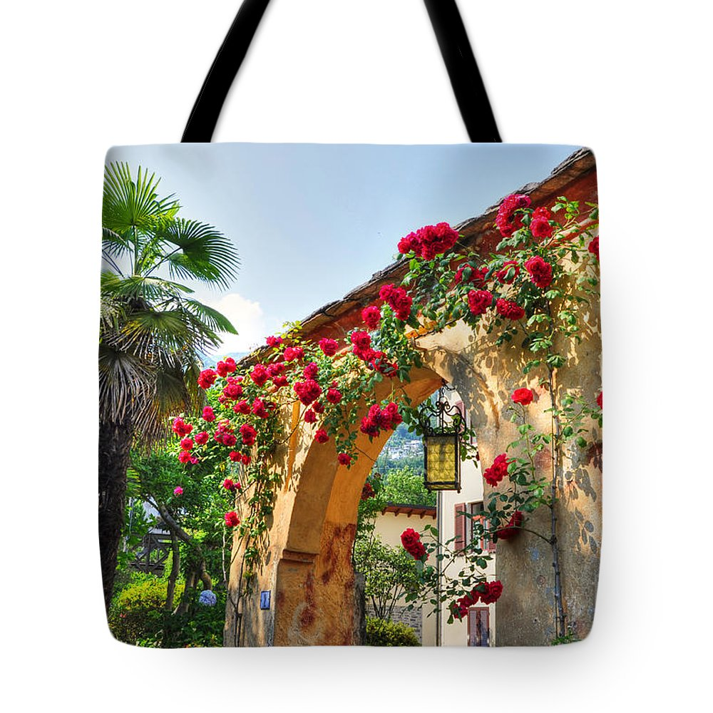 Entrance Tote Bag featuring the photograph Entrance Arch With Flowers by Mats Silvan